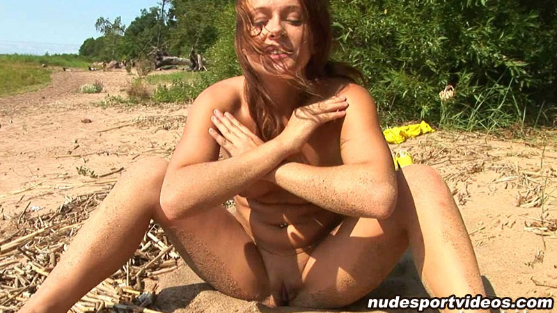 Nude girl training on the beach